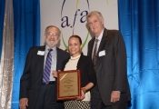 alexandra-schneider-of-switchboard-of-miami-accepts-2015-jose-paulos-above-and-beyond-award-on-behalf-of-lisa-gandolfo