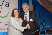amy-gotwals-of-n4a-the-keynote-speaker-receives-gift-of-appreciation-for-newly-installed-chair-robert-h-foley